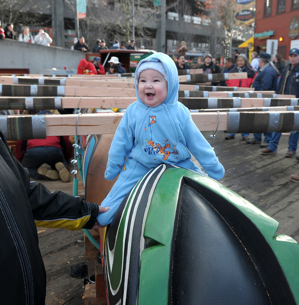 This beautiful child shares a smile just before the JTW Totem begins its journey to the Seattle Center