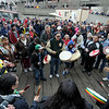 Sacred Waters canoe family lend their strong drums to the day