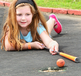 Kevin Harvison | Staff photo Anne Belle Texter eyes up a shot to finish her put at Jelley Stone Park's putt putt golf course.