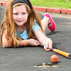 Kevin Harvison | Staff photo<br /> Anne Belle Texter eyes up a shot to finish her put at Jelley Stone Park's putt putt golf course.