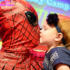 Kevin Harvison | Staff photo<br /> Harmony Meeks gives Spider Man, a.k.a. Chris Meeks, a kiss after his daughter Harmony Meeks found out costumed hero goes by another name, Daddy. Meeks and several other vounteers dresses up recently during a Summer Day Camp.