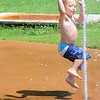 Kevin Harvison | Staff photo<br /> Ian Bryant attacks a burst of water at the Chadick Park with his best ninja skills.