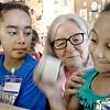 Kevin Harvison | Staff photo<br /> The Grand Avenue Community Center Summer Program 2017 is under way from 7 a.m. until 3 p.m. Maya Thornton, left and Aaliyah Batts shake a jar to make home made butter under the watch of OSU Extension Office representative Delois Crone.