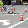Kevin Harvison | Staff photo<br /> McAlester city employee Jeremy Lewis paints the intersection of Third Street and Choctaw Avenue.