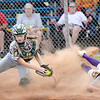 KEVIN HARVISON | Staff photo<br /> Stuart catcher Sydney Howell, left attempts to make a play during fast pitch softball action Thursday at the Pittsburg County Softball Complex.
