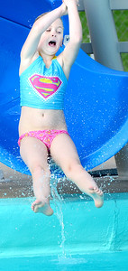 Kevin Harvison | Staff photo Kaiya Jones enjoys the slide at Jeff Lee Pool.