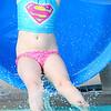 Kevin Harvison | Staff photo<br /> Kaiya Jones enjoys the slide at Jeff Lee Pool.