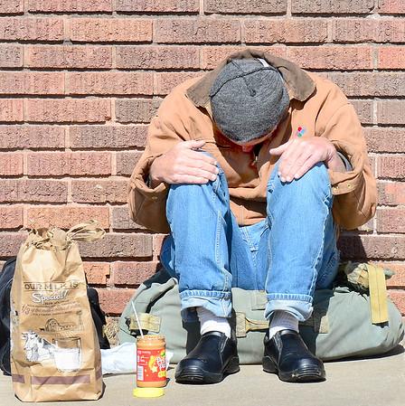 Kevin Harvison | Staff photo<br /> A man sleeps on Second Street near Cherokee Avenue.