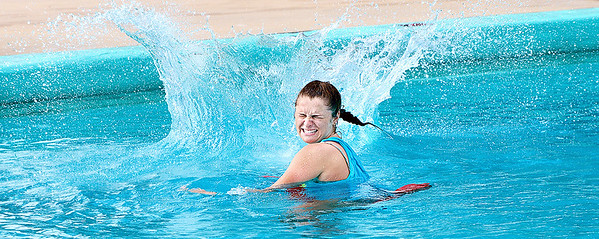"""Kevin Harvison   Staff photo<br /> Jeff Lee Pool Lifeguard Kelby Koonce reacts to the splash of a """"cannon ball"""" as the water approaches."""