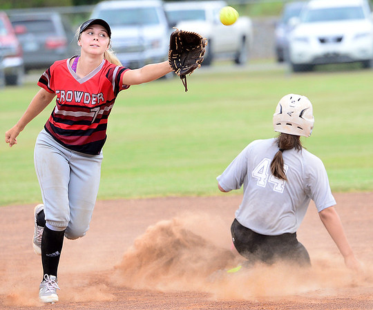 KEVIN HARVISON | Staff photo<br /> Crowder infielder attempts to make a play at second during summer fast pitch softball action at the Pittsburg County Softball Complex Thursday.