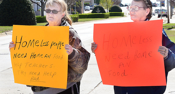 Kevin Harvison | Staff photo<br /> Standing on Carl Albert Parkway, pictured from left, Linda Fry and Bonnie Hatter both of McAlester say they are trying to draw attention and get help for the homeless population here in town.