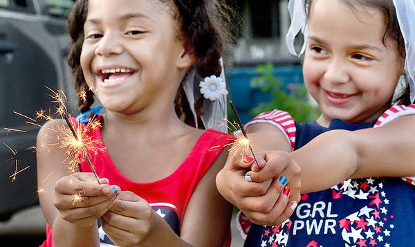 Kevin Harvison | Staff photo<br /> Pictured from left, Kahleeha Walters and her sister Kajua Walters near the end of their sparklers as the two celebrate America's Independance Day.