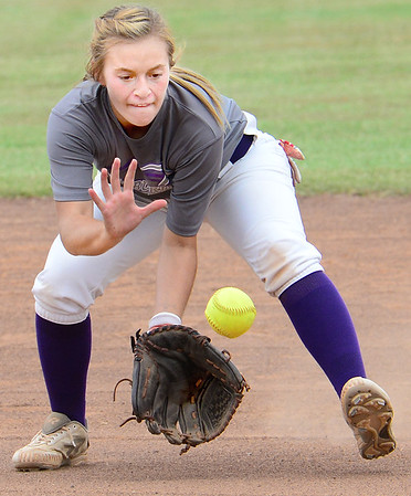 KEVIN HARVISON | Staff photo<br /> Wilburton Digger short stop makes a play during summer softball league action Thursday at the Pittsburg County Softball Complex against Crowder.