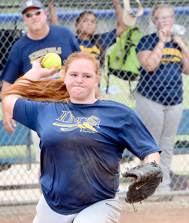 KEVIN HARVISON | Staff photo<br /> Indianola third baseman prepares to throw the ball to first during summer fast pitch softball action at the PIttsburg County Softball Complex Thursday.