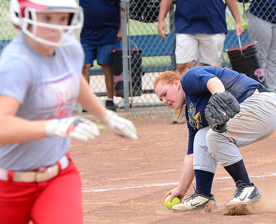 KEVIN HARVISON | Staff photo<br /> An Indianola fielder eyes a Smithville runner before making the throw during summer league softball action Thursday at the Pittsburg County Softball Complex.