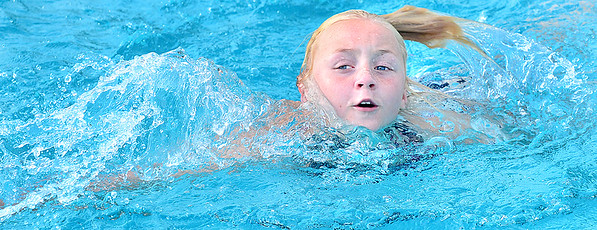 Kevin Harvison | Staff photo<br /> Hannah Cox cools off at the Jeff Lee Public Pool.