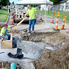 KEVIN HARVISON | Staff photo<br /> A McAlester City Crew works on a Form to concrete a storm water drainage box at the corner of Chadick Avenue and Fifth Street. The section of road is scheduled to be open by end of next week if all goes to plan.