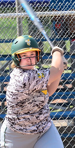 KEVIN HARVISON | Staff photo Stuart Hornet batter Emily Smith hits the ball during Tuesday summer league play at the Pittsburg County Softball Complex.