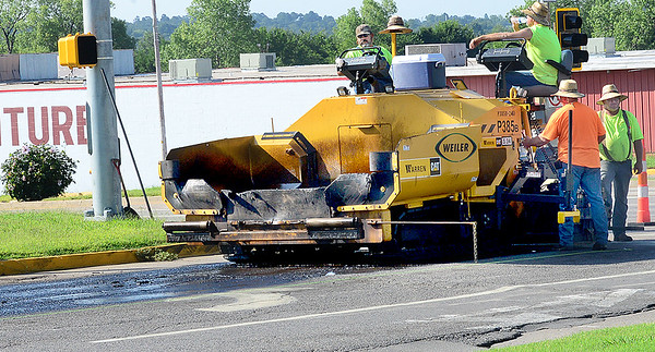 KEVIN HARVISON |<br /> A McAlester City Roads crew prepare to work on North Sixth Street off of Carl Albert Parkway Tuesday morning.