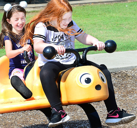 KEVIN HARVISON | Staff photo<br /> Pictured from left, Lillee McDowell and Cali Farris enjoy a day at Chadick Park.