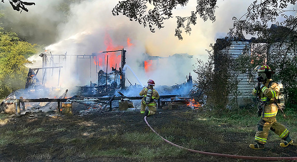 KEVIN HARVISON |<br /> McAlester Fire Fighters work to extinguish a structure fire on B Street and Bolen Avenue Monday morning.