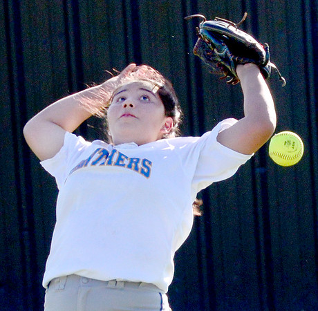 KEVIN HARVISON | Staff photo Pittsburg High School outfielder attempts to make a play on the ball during KIowa Summer League Softball action Thursday.