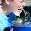KEVIN HARVISON | Staff photo<br /> Bran Chapman of McAlester gets a much needed drink while playing at Chadick Park.