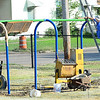 KEVIN HARVISON | Staff photo<br /> New playground equipment is being installed at Parker Middle School. The school had no equipment in the field for the children to play on.