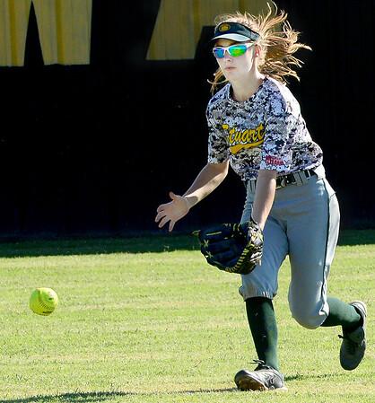 KEVIN HARVISON | Staff photo<br /> Stuart High School softball outfielder makes a play on a ball hit during KIowa Summer League Softball action Thursday.