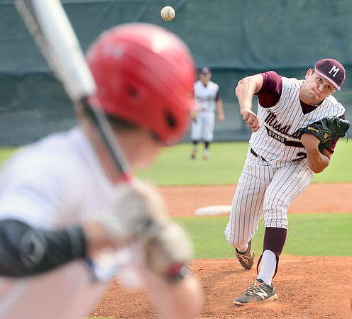 Kevin Harvison | Staff photo<br /> Mississippi pitcher Chance Denson fires a pitch to an Oklahoma Blue batter during Junior Sunbelt action at Mike Deak Field Friday.