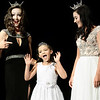 Kevin Harvison | Staff photo<br /> 2017 Miss McAlester Kyleeann Parker, left, and 2017 Miss McAlester's Outstanding Teen Macey Sexton, right, look on as a 2018 Little Star contestant Pazlye Coronel reacts to the crowd during the 2018 Miss McAlester Scholarship Pageant contest at S. Arch Thompson Auditorium Saturday.