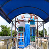 Staff photo by Kevin Harvison |<br /> Pictured from left, Dakota Powell and Rex Smith work to install an awning at Eufaula Cove at Lake Eufaula.
