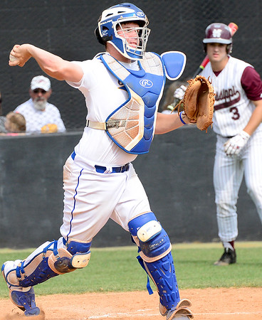 Kevin Harvison | Staff photo<br /> Oklahoma Blue catcher fires a ball to second during action from the Junior Sunbelt at Mike Deak Field Friday.