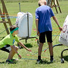 Kevin Harvison | Staff photo<br /> Spencer Czapansky, left, retreaves his arrows archery lessons at the H.E.R.O. Part II Summer Day Camp sponsored by the Kings House Church in McAlester.