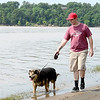 Justin Hathor walks his dog Blackie on the shore of Lake Eufaula recently.