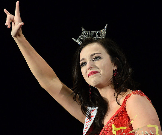 Kevin Harvison | Staff photo<br /> Alexandria Williams waves to the crown after being introduced as the 2018 Miss McAletser winner Saturday night at S. Arch Thompson Auditorium.  The former McAlester High School student now attends the University of Oklahoma.