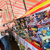 Kevin Harvison | Staff photo<br /> Pictured from left are, Kevin Beaty and Joe Yagher as the two volunteers restock the shelves at the TNT Fireworks stand near Peaceable Road and south U.S. Highway 69. All proceeds will go towards helping fund Summer Day Camp and students attending Gateway Student Conference in July