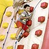 Kevin Harvison | Staff photo<br /> Emerson Elementary student Alex Moreno fights his way to the top of an inflatable obsticle course during the last day of school for McAlester students.