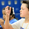 Staff photo by Kevin Harvison |<br /> Pictured from left, Emerson Elementary students Bishop Wright and Hayden Jennings race to stack dice on a stick from their mouth during the last day of school for McAlester.