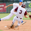 Kevin Harvison | Staff photo<br /> Oklahoma Blue short stop attempts to get the ball during action from the Junior Sunbelt at Mike Deak Field Friday.