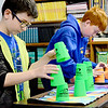 Kevin Harvison | Staff photo<br /> Frink Chambers 5th grade students Ethan Boyanton, left and Chase Wiliams, work an timed excersise stacking and unstacking cups.