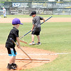 Kevin Harvison | Staff photo<br /> Volunteers of all ages prepare Mike Deak Field for another Junior Sunbelt game.