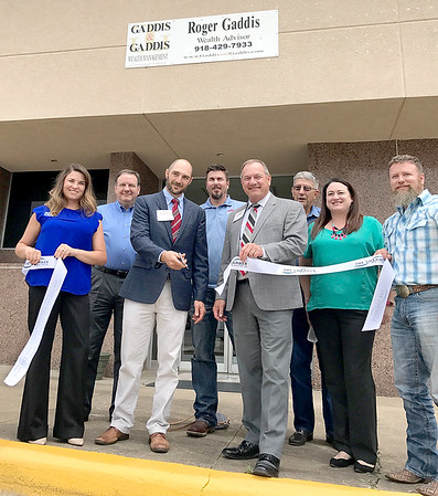 Kevin Harvison | Staff photo<br /> Picture are several who attended the Ribbon Cutting of Gaddis and Gaddis Wealth Managment at their new location at 300 East Choctaw Avenue.