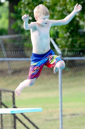 Kevin Harvison   Staff photo<br /> Jettis Jones jumps into Jeff Lee Pool.