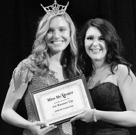 Kevin Harvison | Staff photo<br /> 2018 Miss McAlester Outstanding Teen Maddie Carr, left, poses with the 2019 Miss McAlester First Runner Up Alli Furlong during the 2019 Miss McAlester Scholarship Pageant at S. Arch Thompson Auditorium Saturday.