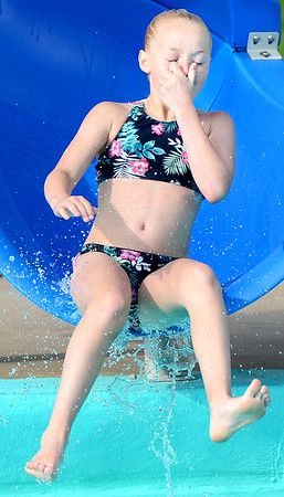 Kevin Harvison | Staff photo<br /> Hannah Cox pinches her nose as she prepares for impact while having fun at Jeff Lee Pool.