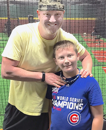 Kevin Harvison | Staff photo<br /> Pictured from left, Pitching coach Brian Shackelford and Hayden Harvison first day of pitching lessons at D-Bat Oklahoma City in Oct. 1 2017.