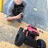 Kevin Harvison | Staff photo<br /> Asher Mason attempts to drive his RC Monster Truck up the Mike Deak stairs before the start of some Junior Sunbelt action.