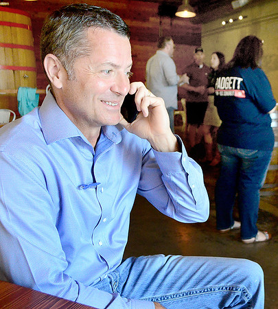 Kevin Harvison | Staff photo<br /> Pictured from left,  Clay Padgett as he takes a call during Padgett watch party in McAlester.