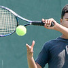 Kevin Harvison | Staff photo<br /> Jay Moore, a McAlester Public Schools 8th grade student, returns the ball during the 47 annual city summer tennis camp.